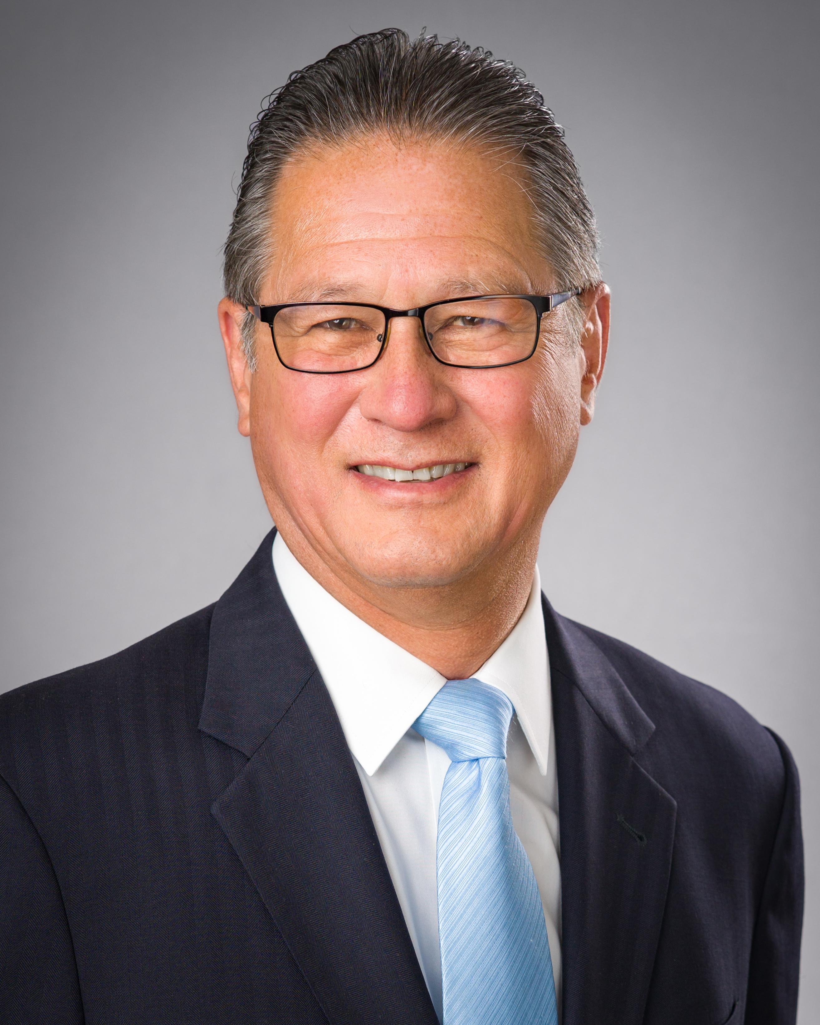 John W. Simek